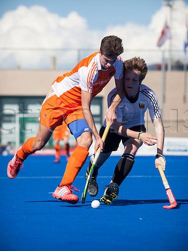 01.04.2013 Valencia, Spain. Dominic Aarts of Holland (L) drives the ball challenged by Noah Winneberger of Germany during the Hockey 4 Nations U18 Men Easter Tournament Valencia 2013 Final game between Germany and Netherlands from the Campo de Hockey Valencia