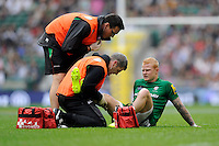 Tom Homer of London Irish leaves the field having injured his thigh during the Premiership Rugby Round 1 match between London Irish and Harlequins at Twickenham Stadium on Saturday 6th September 2014 (Photo by Rob Munro)