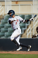 Johan Cruz (5) of the Kannapolis Intimidators follows through on his swing against the Greensboro Grasshoppers at Kannapolis Intimidators Stadium on August 5, 2018 in Kannapolis, North Carolina. The Intimidators defeated the Grasshoppers 9-0 in game two of a double-header.  (Brian Westerholt/Four Seam Images)