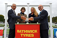 Connections of Vixen receive their trophy from sponsors after winning The Bathwick Tyres Handicap (Div 1) during Bathwick Tyres Reduced Admission Race Day at Salisbury Racecourse on 9th October 2017