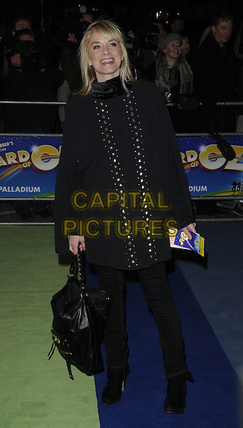 """TAMZIN OUTHWAITE.The Press Night for the new musical stage production of the """"Wizard of Oz"""", London Palladium, London,.England, UK..March 1st, 2011.full length black coat bag poncho trousers .CAP/CAN.©Can Nguyen/Capital Pictures."""