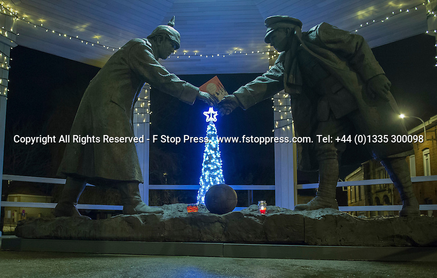 """25/12/14<br /> <br /> A  sculpture depicting two WW1 soldiers playing football during the famous Christmas Day truce is displayed in Messine square, Belgium, close to where the match was played in Flanders, Belgium.<br /> <br /> The sculpture, made in England, arrived in Flanders on Christmas Eve, and was first displayed in the town centre before being taken to the spot where the match was played. <br /> <br /> Sculpted by Andy Edwards the work is entitled 'All Together Now', recalling the song by the band The Farm - which was inspired by the truce. <br /> <br /> Chris Butler said: """"Castle Fine Arts are proud to have cast a number of war memorials over the years. We are honoured to support this sculpture for peace. I believe it will touch the hearts of millions.""""<br /> <br /> <br /> """"It will be a symbol of peace and hope and a call for a renewed worldwide cessation of violence in honour of those brave boys who 'joined together and decided not to fight'"""".<br /> <br /> <br /> The statue depicts the meeting of a British and a German soldier over a football, deep in the mud between the lines on that first Christmas of the war. The soldiers appear to be shaking hands but  are not not quite touching, forming a space in which a visitor can insert their own hand to complete the union.  A chance for a moments reflection on how far we are from true peace and brotherhood and the part each of us has to play in that dream. We want the work to stand as both a celebration of this inspirational and heroic event and as symbol of hope and peace. <br /> <br /> The project was instigated some years ago, with the support of the Football Asscociation (FA), as football's contribution to the First World War commemorations. <br /> <br /> All Rights Reserved - F Stop Press. www.fstoppress.com. Tel: +44 (0)1335 300098"""