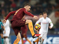 Calcio, Serie A: Roma vs ChievoVerona. Roma, stadio Olimpico, 22 settembre 2016.<br /> Roma&rsquo;s Edin Dzeko controls the ball during the Italian Serie A football match between Roma and Chievo Verona, at Rome's Olympic stadium, 22 December 2016.<br /> UPDATE IMAGES PRESS/Isabella Bonotto