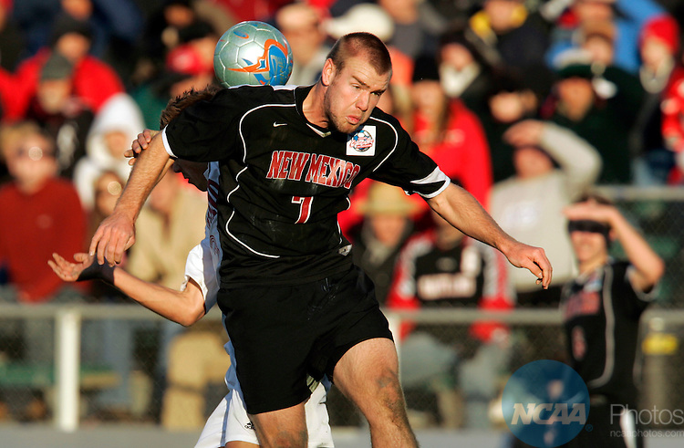 11 DEC 2005:  Brandon Moss (7) of the University of New Mexico out jumps a University of Maryland defend during the Division I Men's Soccer Championship held at SAS Soccer Stadium in Cary, NC.   Maryland defeated New Mexico 1-0 for the national title.  Jamie Schwaberow/NCAA Photos