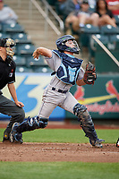 Corpus Christi Hooks catcher Garrett Stubbs (1) throws to second base in front of home plate umpire Tyler Olson during a game against the Springfield Cardinals on May 31, 2017 at Hammons Field in Springfield, Missouri.  Springfield defeated Corpus Christi 5-4.  (Mike Janes/Four Seam Images)