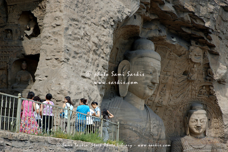 Female tourists at the Yungang Grottoes, Shanxi, China.
