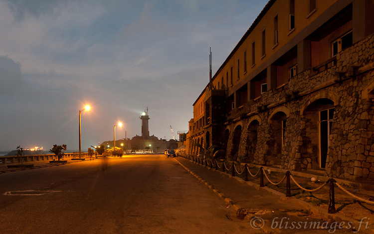 Galbokka Point (Galle Buck) Lighthouse shines at the first light of dawn in Colombo, Sri Lanka.