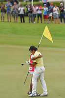 Takumi KANAYA (JPN) hugs his caddie after winning the Asia-Pacific Amateur Championship, Sentosa Golf Club, Singapore. 10/7/2018.<br /> Picture: Golffile | Ken Murray<br /> <br /> <br /> All photo usage must carry mandatory copyright credit (&copy; Golffile | Ken Murray)
