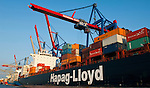 Hamburg-Germany - May 04, 2013 -- Port of Hamburg / harbour at the river Elbe: container cranes at CTB Container Terminal Burchardkai (HHLA, Hamburger Hafen und Logistik Aktiengesellschaft), with a container ship run by Hapag-Lloyd; Infrastructure -- Photo: © HorstWagner.eu