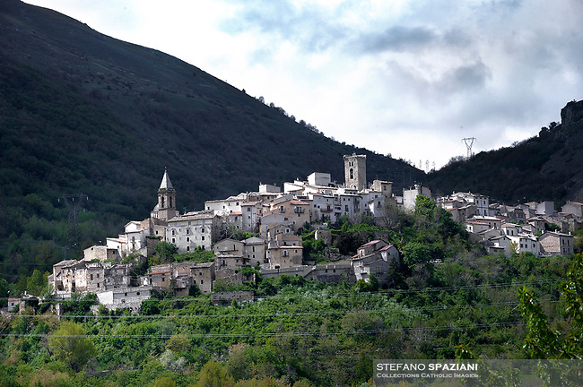"""Landscape of the Cocullo Country.The feast of snakes. Process dedicated to the Saint Dominic, in the streets of Cocullo, in the Abruzzo region, Italy on May 1, 2019.<br /> <br /> <br /> <br /> The St. Domenico's procession in Cocullo, central Italy. Every year on the first  of May, snakes are placed onto the statue of St. Domenico and then the statue is carried in a procession through the town. St. Domenico is believed to be the patron saint for people who have been bitten by snakes:<br /> <br /> Italy, Cocullo, in the Province of L'A...quila, is at 870 meters a.s.l., along the railway line connecting Sulmona to Rome. The village rises alongside Mount Luparo (1327 meters) """"The valley opening in front of the village is surrounded by bare rocks, while on the other side, to the south, snow-capped mountain crests follow one after the other...""""<br /> San Domenico Abate lived in the 10th and 11th centuries AD. Born in Foligno, in the Umbria region, he started his pilgrimages, preaching and ascetic practices in Central Italy, making miracles recorded by the word-of-mouth tradition. He died on 22 January 1031 and was buried in Sora.<br /> <br /> Cocullo snake charmers are over with their snake hunting. They proceeded through the During the procession on the first in May, before the snakes are placed all over the statue of St. Dominick, they will be fed with milk kept in containers with crusca. It is the snake that, most of all other elements, expresses an ancestral myth: the unknown aspect and unpredictability of the natural environment with man's innate need to achieve the dominance on his own habitat. <br /> <br /> Snakes and wolves were the emblems of Italic peoples like the Marsians and Irpinians. Some areas in Abruzzo, especially in the Sagittario valley, were under the menace of wolves and snakes, which for the local populations represented the uncertainty and anxiety of their existence that, together with the precariousness and hardships of life, were almost unbearab"""