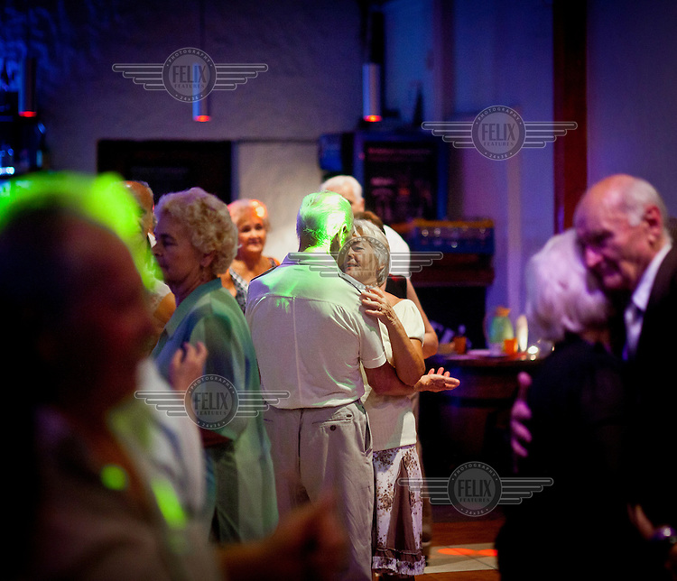 Pensioners dance at the Bolek Club at an event run by Wika Szmyt, a 74 year old DJ, Poland's oldest.