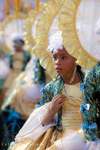 Trinidad Junior Carnival,St James, Rosalind Gabriel's  Band 'Many Faces One Nation' English section in crinolines and masks
