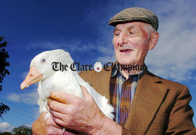 Tom Moroney of Kilfoydane Spancilhill pictured on his farm with his 35 year old Goose.Pic Arthur Ellis.