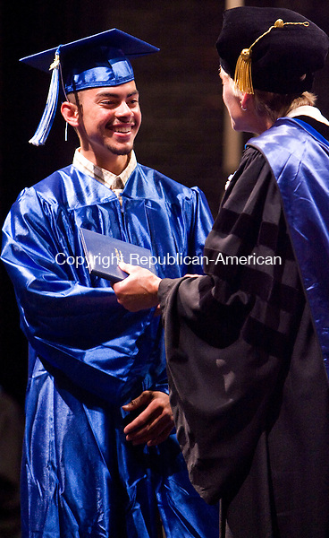 TORRINGTON, CT - 22 JUNE 2010 -062210JT05-<br /> Lewis Mills graduate Paul Rodriguez receives his diploma from Principal Dr. Karissa Niehoff during commencement ceremonies in Torrington on Tuesday.<br /> Josalee Thrift Republican-American