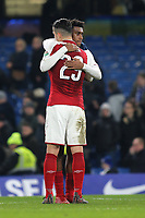 Granit Xhaka of Arsenal hugs Alex Iwobi at the final whistle during Chelsea vs Arsenal, Caraboa Cup Football at Stamford Bridge on 10th January 2018