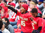 College Park, MD - OCT 1, 2016: A young Terps fan is excited as he sees himself on the jumbotron during game between Maryland and Purdue at Capital One Field at Maryland Stadium in College Park, MD. The Terps got the win 50-7 over visiting Purdue. (Photo by Phil Peters/Media Images International)