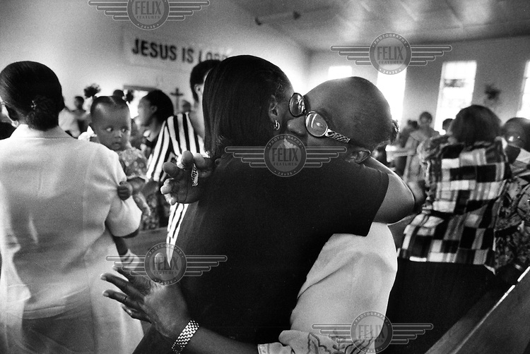 © Dieter Telemans / Panos Pictures..Gospel, South-Africa, Zuid-Afrika, december 2000..Sunday service at the Uniting Reformed Church in Soweto..Zondagsmisviering in de Uniting Reformed Church in Soweto...Trefw. : geloof, religie, misdienst, homosexualiteit, zingenPhoto:  Dieter Telemans / Panos Pictures/Felix Features