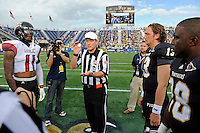 24 September 2011:  FIU quarterback Wesley Carroll (13), running back Darriet Perry (28) and ULL linebacker Devon Lewis-Buchanan (11) watch the coin toss prior to the game.  The University of Louisiana-Lafayette Ragin Cajuns defeated the FIU Golden Panthers, 36-31, at FIU Stadium in Miami, Florida.