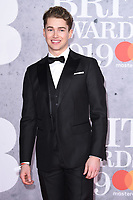 LONDON, UK. February 20, 2019: AJ Pritchard arriving for the BRIT Awards 2019 at the O2 Arena, London.<br /> Picture: Steve Vas/Featureflash<br /> *** EDITORIAL USE ONLY ***