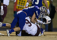 NWA Democrat-Gazette/BEN GOFF @NWABENGOFF<br /> Andrew Robertson (2), Booneville defender, tackles Ryan Johnson (9), Prescott quarterback, in the first quarter, causing him to lose his helmet, Saturday, Dec. 1, 2018, during the class 3A state semifinal game at Bearcat Stadium in Booneville.