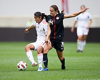 Stephanie Cox (14) of the USWNT fights for the ball with Fany Mayor (21) of Mexico during the game at Red Bull Arena in Harrison, NJ.  The USWNT defeated Mexico, 1-0.