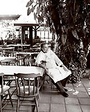 Brazil, Belem, South America, chef sitting in outdoor restaurant (B&W)