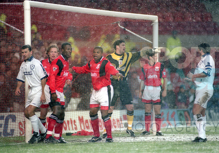 Players from both teams look on as the snow falls, the match was later abandoned  - Premier League - Nottingham Forest v Tottenham  - City ground - Nottingham - England -  19th February1996 - Picture Sportimage