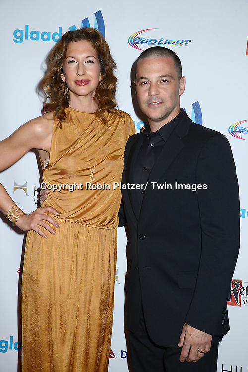 Alysia Reiner and David Bashe attends the 25th Annual GLAAD Media Awards at the Waldorf Astoria Hotel in New York City, NY on May 3, 2014.
