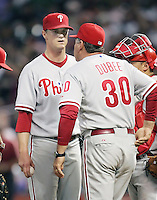 Philadelphia Phillies pitcher Kyle Kendrick meets with pitching coach Rich Dubee on Thursday May 22nd at Minute Maid Park in Houston, Texas. Photo by Andrew Woolley / Four Seam Images..