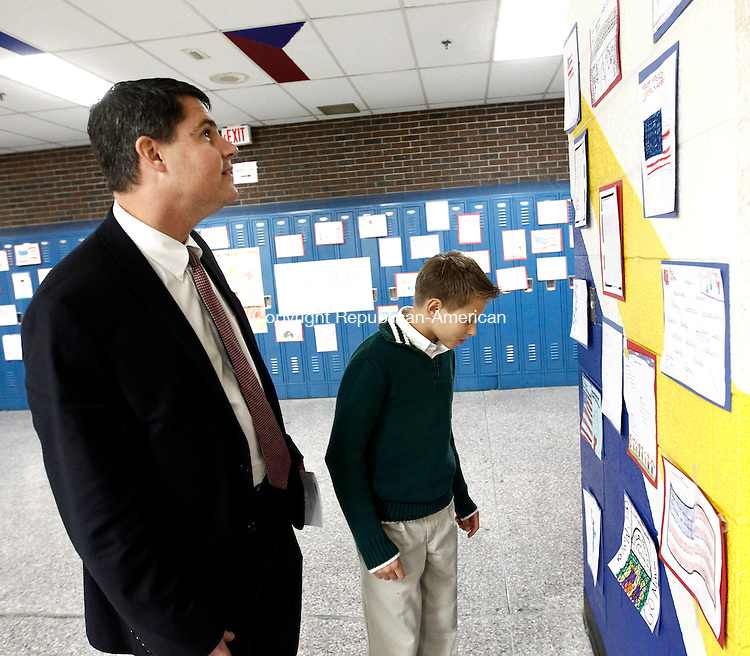 "Naugatuck, CT- 18 November 2013-111813CM04-  Naugatuck Mayor Robert A. Mezzo and his son, Jay, 11, look at artwork from students congratulating Mayor Mezzo on the walls of City Hill Middle School in Naugatuck Tuesday night.  The town held an inauguration for Mezzo, who was re-elected for a third consecutive term.  The event featured the ""Star Spangled Banner"" sung by the Naugatuck High School Chambers Singers, speeches from State Representatives and the oath of office was given by Judge of Probate, Pete Mariano.    Christopher Massa Republican-American"