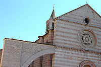 Assisi – A part of the façade of the ancient  Santa Chiara church, with its beautiful alternance of white and rose-coloured bricks. Digitally Improved Photo.