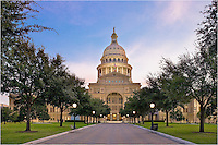 From downtown Austin, Texas, the State Capitol building serves as the center of government for the Lone Star State. The light was just beginning to show across the area in the early morning and the lights from the dome were still glowing.