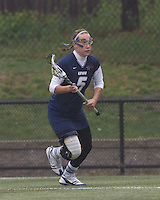 University of New Hampshire defender Erin Levesque (5) brings the ball forward.  Boston College defeated University of New Hampshire, 11-6, at Newton Campus Field, May 1, 2012.