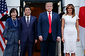 US President Donald J. Trump (2-R) and First Lady Melania Trump (R) greet Japanese Prime Minister Shinzo Abe (L) and First Lady Akie Abe (2-L) at the South Portico of the White House in Washington, DC, USA, 26 April 2019. President Trump is hosting a dinner for Prime Minister Abe and his wife celebrating First Lady Melania Trump's 49th birthday<br /> Credit: Shawn Thew / Pool via CNP
