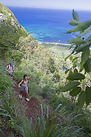 People hiking Kealia Trail, near Dillingham Airfield, on the North Shore of Oahu