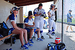 Coaches Beth Henry-Herman, left, and Leah Wentworth talk with Cara McCarthy and Andi Lee in the dugout during a college softball game on Friday, May 2, 2014, in Carson City, Nev.<br /> Photo by Cathleen Allison/Nevada Photo Source