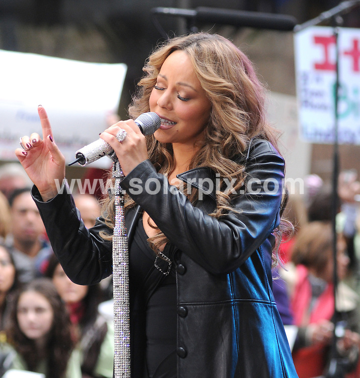 "**ALL ROUND PICTURES FROM SOLARPIX.COM**.**SYNDICATION RIGHTS FOR UK, AUSTRALIA, DENMARK, PORTUGAL, S. AFRICA, SPAIN & DUBAI (U.A.E) ONLY**.Pop singer Mariah Carey in Concert on NBC's ""Today Show"" at the Rockefeller Center in New York City, NY, USA ..This pic:Mariah Carey..JOB REF:10052     PHZ/Mayer    DATE: 02.10.09.**MUST CREDIT SOLARPIX.COM OR DOUBLE FEE WILL BE CHARGED**.**MUST NOTIFY SOLARPIX OF ONLINE USAGE**.**CALL US ON: +34 952 811 768 or LOW RATE FROM UK 0844 617 7637**"