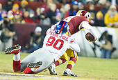 New York Giants defensive end Jason Pierre-Paul (90) sacks Washington Redskins quarterback Kirk Cousins (8) in the fourth quarter of the game at FedEx Field in Landover, Maryland on Thursday, November 23, 2017.  The Redskins won the game 20 - 10.<br /> Credit: Ron Sachs / CNP<br /> (RESTRICTION: NO New York or New Jersey Newspapers or newspapers within a 75 mile radius of New York City)
