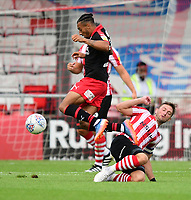Lincoln City's Lee Frecklington vies for possession with Swindon Town's Keshi Anderson<br /> <br /> Photographer Chris Vaughan/CameraSport<br /> <br /> The EFL Sky Bet League Two - Lincoln City v Swindon Town - Saturday 11th August 2018 - Sincil Bank - Lincoln<br /> <br /> World Copyright &copy; 2018 CameraSport. All rights reserved. 43 Linden Ave. Countesthorpe. Leicester. England. LE8 5PG - Tel: +44 (0) 116 277 4147 - admin@camerasport.com - www.camerasport.com