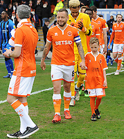 Blackpool's Jay Spearing leads the side out along with a match day mascot<br /> <br /> Photographer Kevin Barnes/CameraSport<br /> <br /> The EFL Sky Bet League One - Blackpool v Gillingham - Saturday 4th May 2019 - Bloomfield Road - Blackpool<br /> <br /> World Copyright © 2019 CameraSport. All rights reserved. 43 Linden Ave. Countesthorpe. Leicester. England. LE8 5PG - Tel: +44 (0) 116 277 4147 - admin@camerasport.com - www.camerasport.com