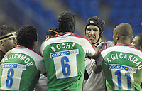 Reading, GREAT BRITAIN,    London Irish player confront, Justin HARRISON  about an disagreement  of the ball , during the third round Heineken Cup game, London Irish vs Ulster Rugby, at the Madejski Stadium, Reading ENGLAND, Sa, t 09.12.2006. [Photo Peter Spurrier/Intersport Images]..