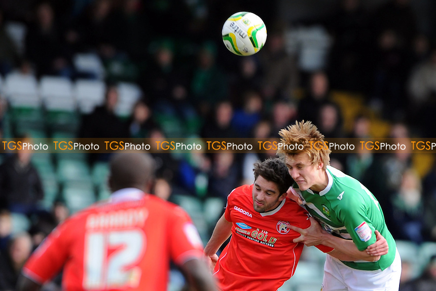 Dan Burn of Yeovil Town wins a header - Yeovil Town vs Walsall - NPower League One Football at Huish Park, Yeovil, Somerset - 29/03/13 - MANDATORY CREDIT: Denis Murphy/TGSPHOTO - Self billing applies where appropriate - 0845 094 6026 - contact@tgsphoto.co.uk - NO UNPAID USE.