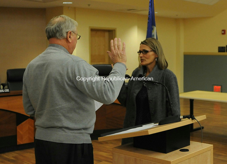 """TORRINGTON, CT- 7 December 2015- 08120715BJ01-- Democrat Fiona Cappabianca recites the oath of office for her second term on Board of Education on Monday at City Hall. City Clerk Joseph Quartiero administreted the oath. Cappabianca and 21 other residents took the oath of office for various boards and positions, including constables, selectmen, Board of Education, Board of Public Safety, City Council and treasurer. Mayor Elinor Carbone told the city officials the oath is a """"life-changing commitment to the city."""" Bruno Matarazzo Jr. Republican-American"""