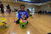 NWA Democrat-Gazette/J.T. WAMPLER Jaxson Cowan, 4, collects treat-filled eggs Sunday April 14, 2019 during Easter at the Club at the Donald W. Reynolds Boys and Girls Club in Fayetteville. Around 16 thousand eggs were filled for the event. Jaxson came to the event with his mom, Jessica Cowan of Fayetteville.