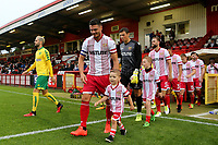 Ronny Henry leads out the Stevenage players prior to kick-off during Stevenage vs Norwich City, Friendly Match Football at the Lamex Stadium on 11th July 2017