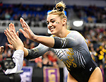 The SEC National Gymnastic Championship was held on Saturday March 24 at Chaifetz Arena on the Saint Louis University campus. Mizzou&rsquo;s Morgan Porter gets high-fives from teammates after her floor performance.<br />