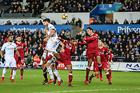 Virgil van Dijk of Liverpool heads from a Swansea attack during the Premier League match between Swansea City and Liverpool at the Liberty Stadium, Swansea, Wales on 22 January 2018. Photo by Mark Hawkins / PRiME Media Images.