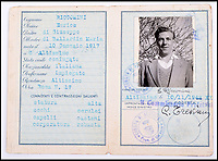 BNPS.co.uk (01202 558833)Pic: C&amp;TAuctions/BNPS<br /> <br /> Lieutenant James Riccomini MBE's fake italian passport.<br /> <br /> The remarkable story of an SAS hero who escaped captivity by jumping out of a moving train and carried out daring raids behind enemy lines before he was killed storming a German stronghold can be told after his bravery medals emerged for sale.<br /> <br /> After escaping his German captors, Lieutenant James Riccomini MBE spent four months assisting Italian resistance fighters with ammunition drops and intelligence gathering before scaling the Alps to reach neutral Switzerland when his cover was blown.<br /> <br /> Ten months later, he was dropped behind enemy lines and led a fearless ambush of a German armoured column before he was killed in action heading up an assault during the legendary Operation Tombola.<br /> <br /> His MBE, Military Cross and other medals along with letters he wrote to his wife, documents and photos are tipped to sell for &pound;12,000.