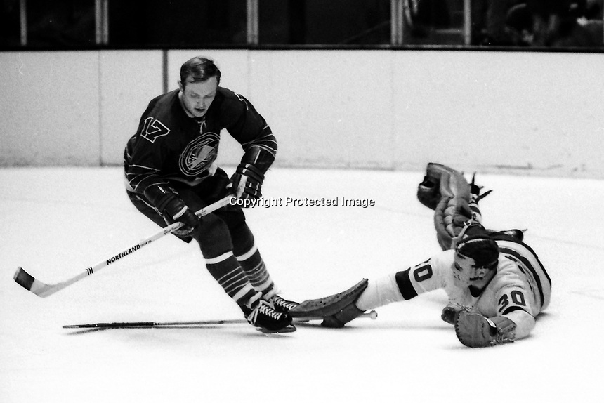 Seals Norm Ferguson scates on Los Angeles Kings goalie Gerry Desjardins or Denis DeJordy. (1969 photo by Ron Riesterer)