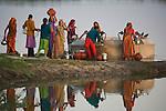 Gujarat women filling water pots at well, Gujarat, India